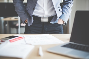 businessman-standing-in-his-office-picjumbo-com